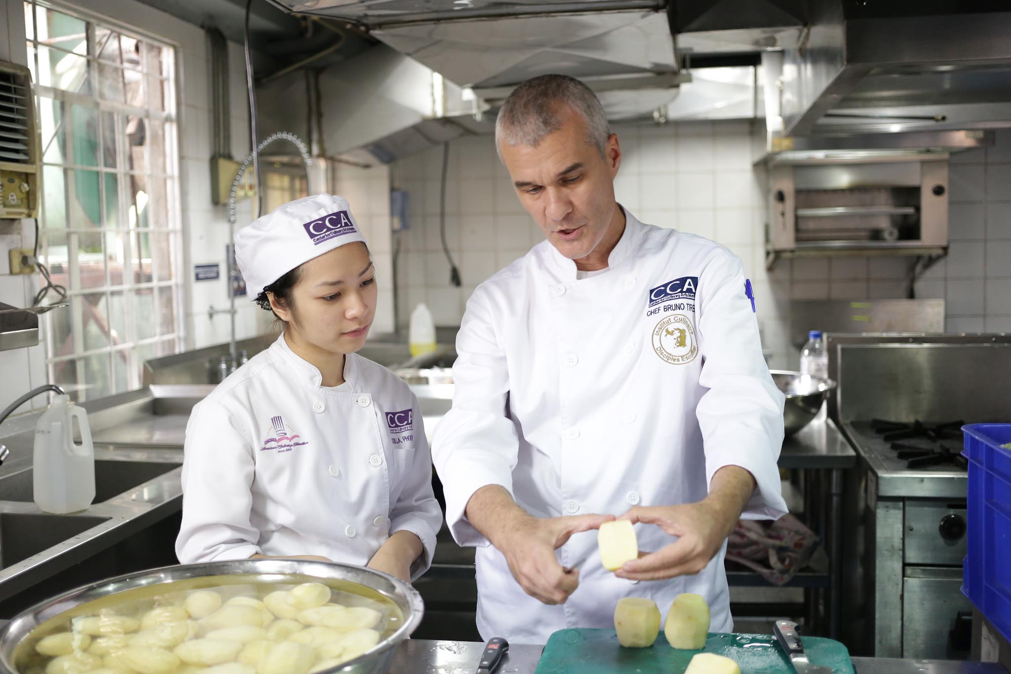 CCA-ICDE chef instructor Bruno Tirel with student |